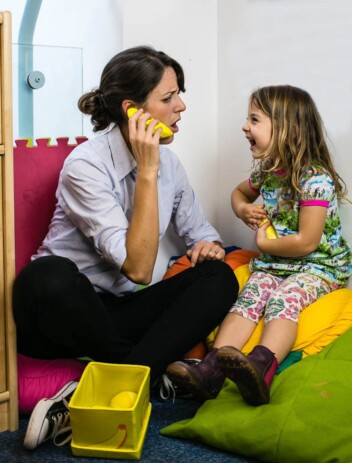 Bryony giving speech therapy to a child